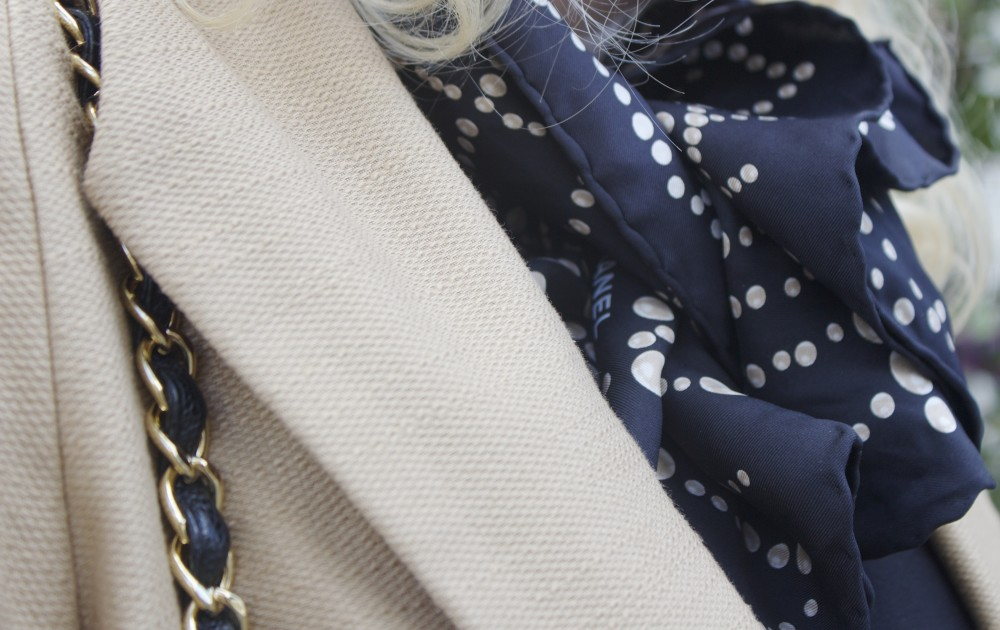 scarf knotted into a bow chanel pearls black