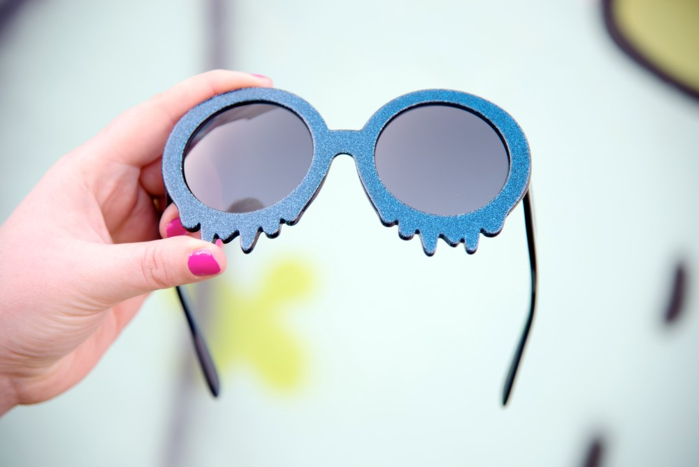 Hayley Elsaesser dripping melting sunglasses blue glitter
