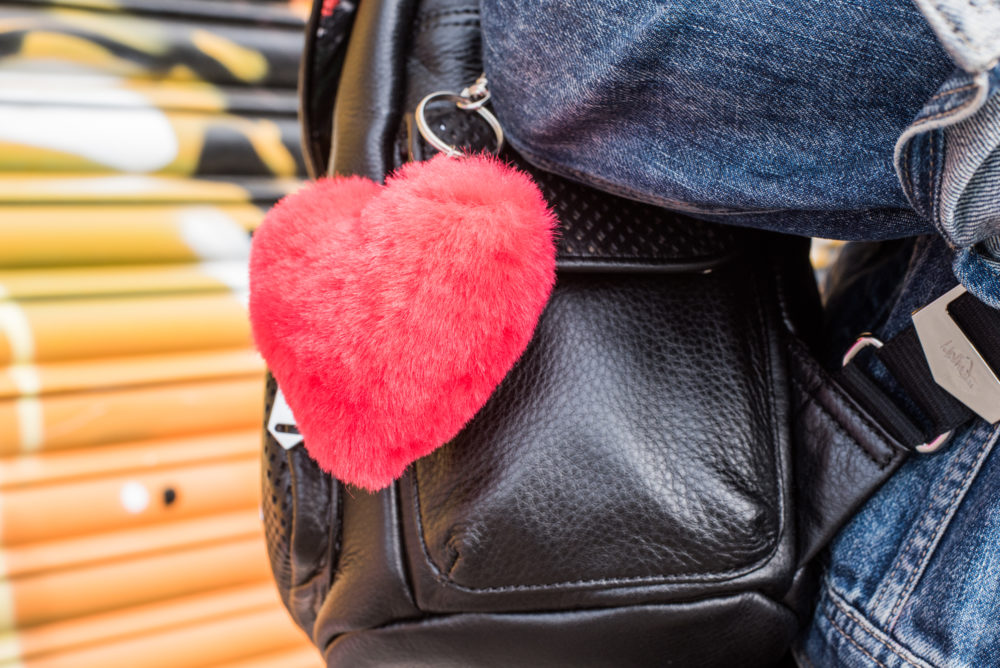 accessorize fur charm bag pompom heart