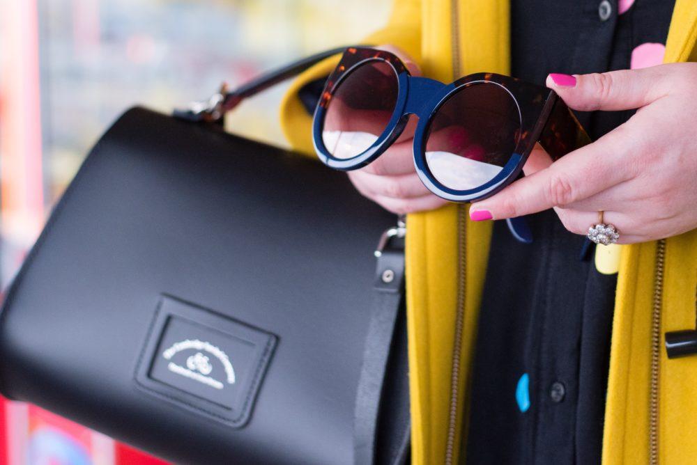 boden-yellow-duffle-coat-and-cambridge-satchel-company-handbag-back-view