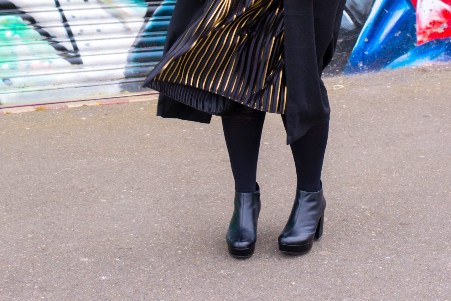 asos skirt blowing in the wind pleated black gold