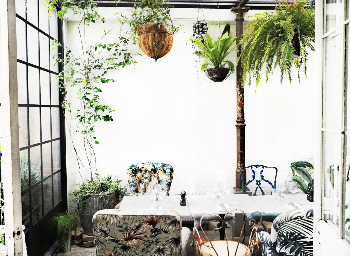 Bourne-Hollingsworth-green-hanging-plants-and-white-brick-walls