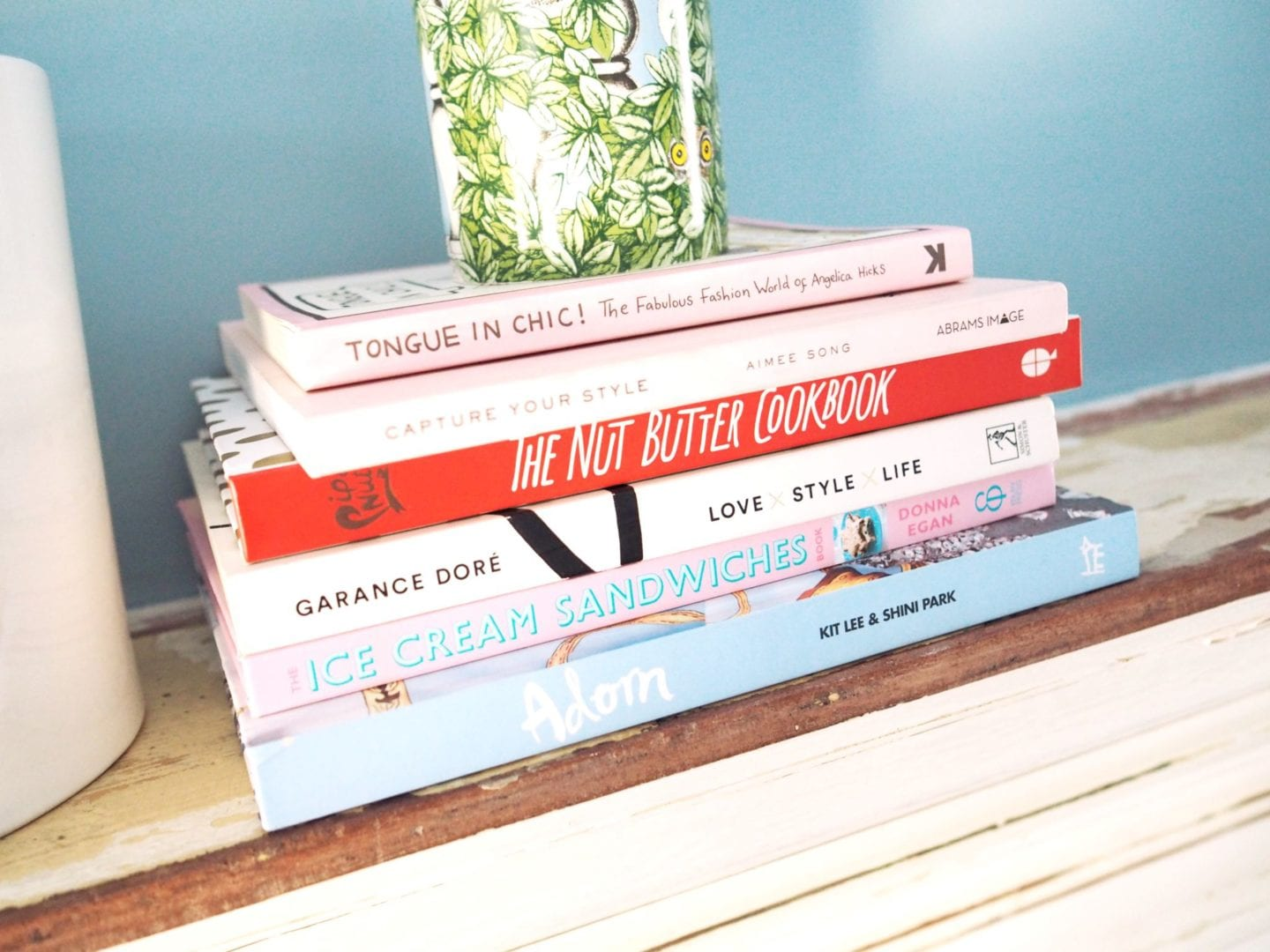 coffee-table-books-on-fireplace