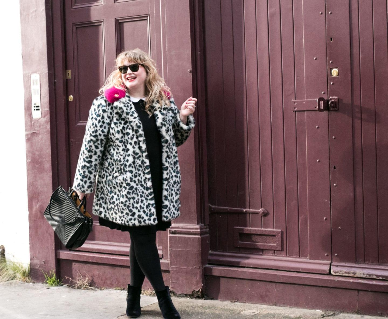 pink fur coat and coach rogue handbag