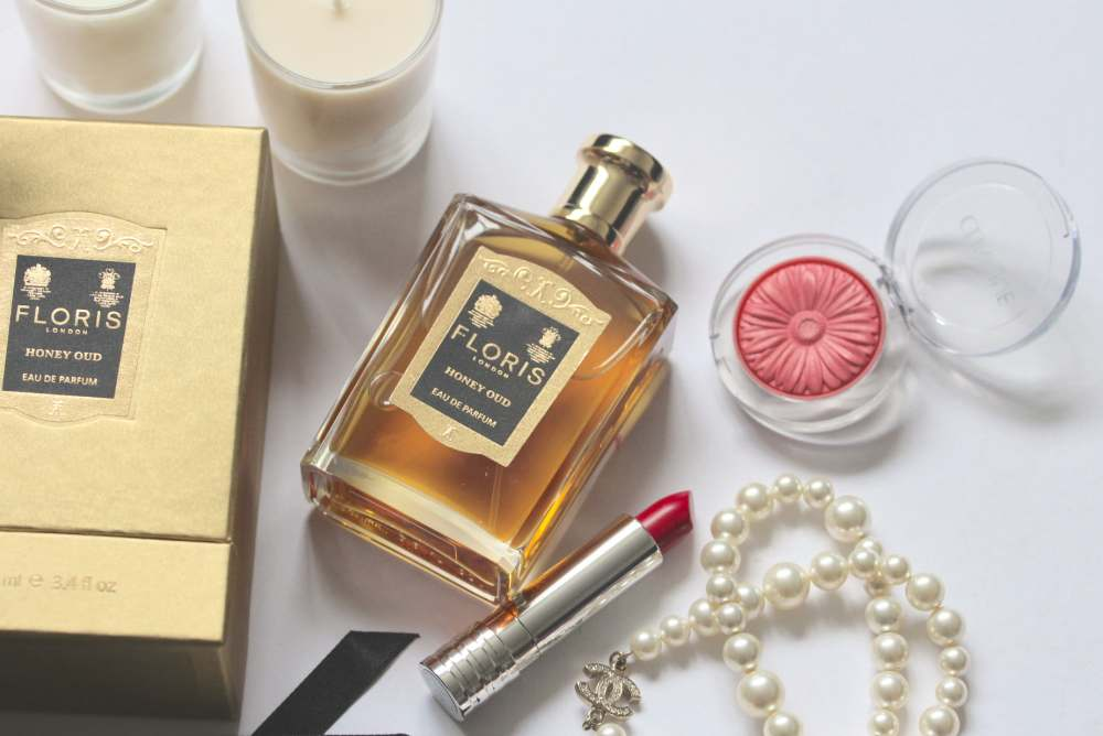 floris london honey oud perfume fragrance scent cologne clinique blush chanel pearls flatlay