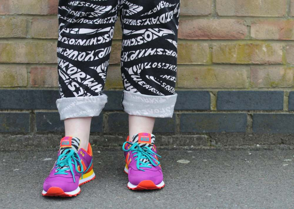 new balance trainers and vintage moschino trousers