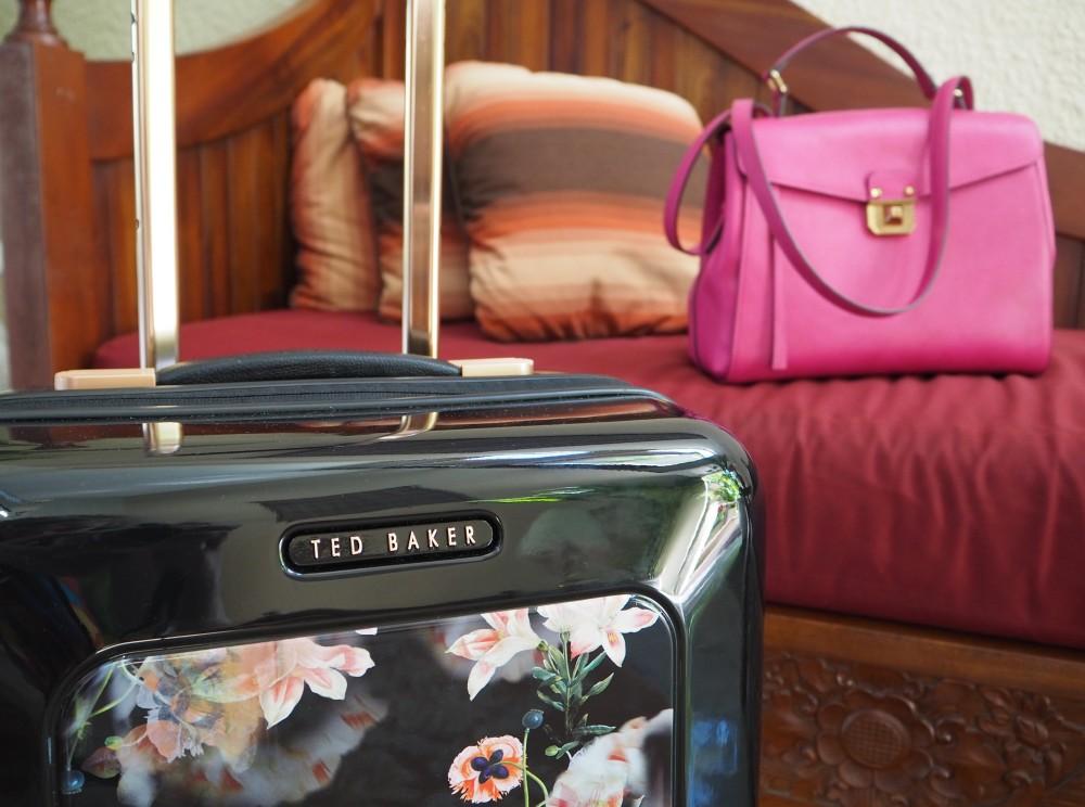 ted baker designer flight suitcase floral design black travel case rose gold detailing  mcm worldwide pink kelly bag