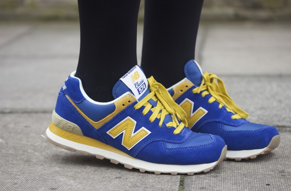 blue and yellow new balance trainers from getthelabel.com
