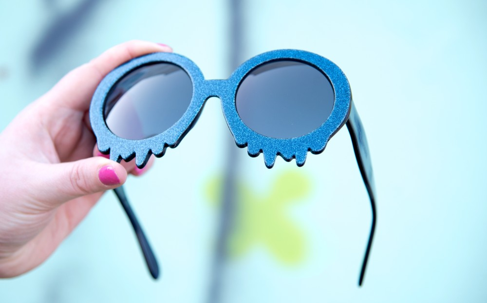 Hayley Elsaesser dripping melting sunglasses blue glitter