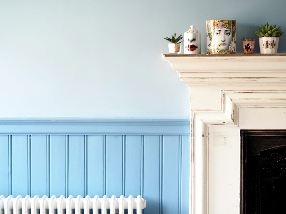 orignal-fire-place-with-blue-wood-panneling-and-walls
