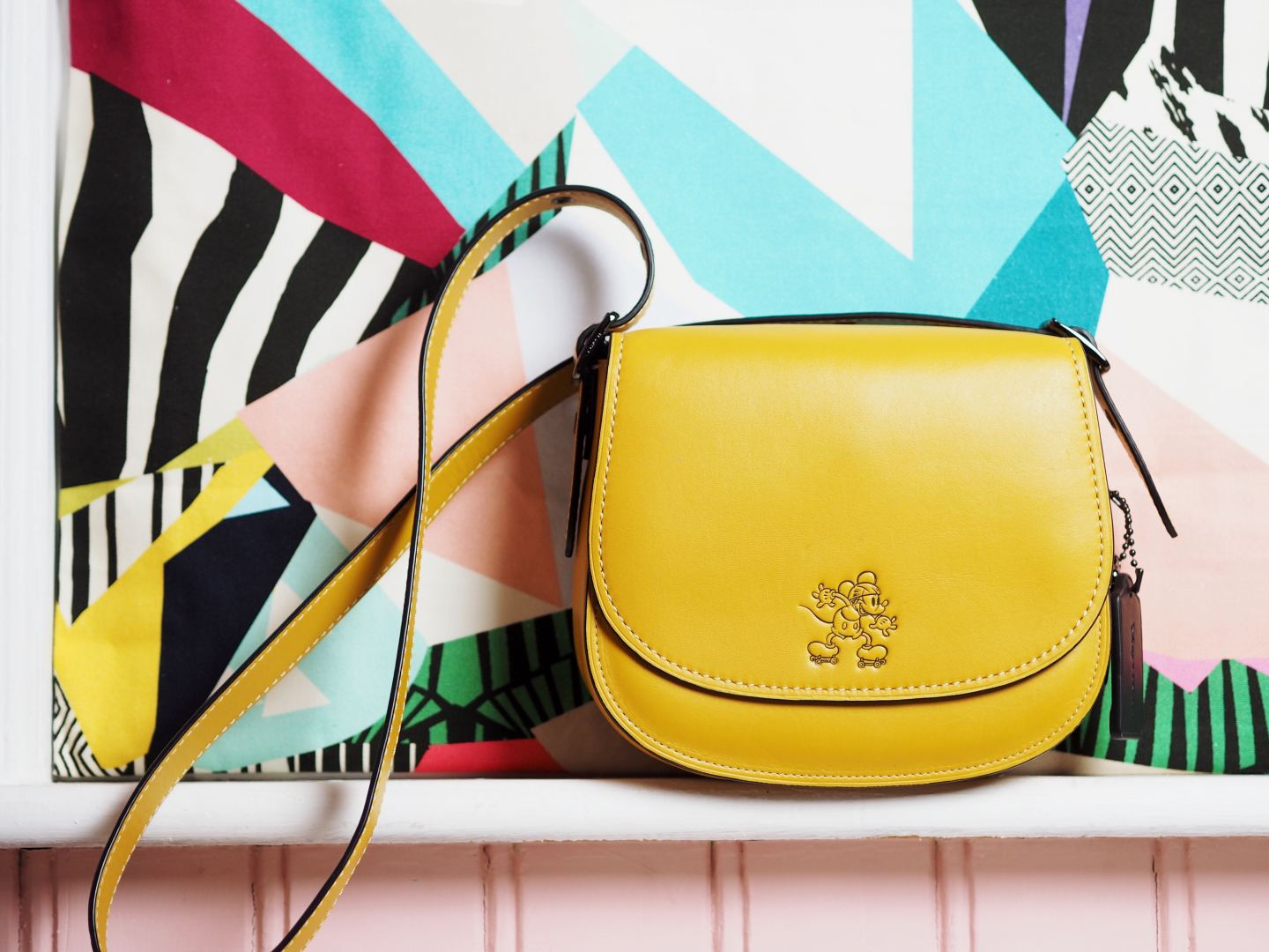 The Coach Saddle Bag yellow x disney collection collaboration