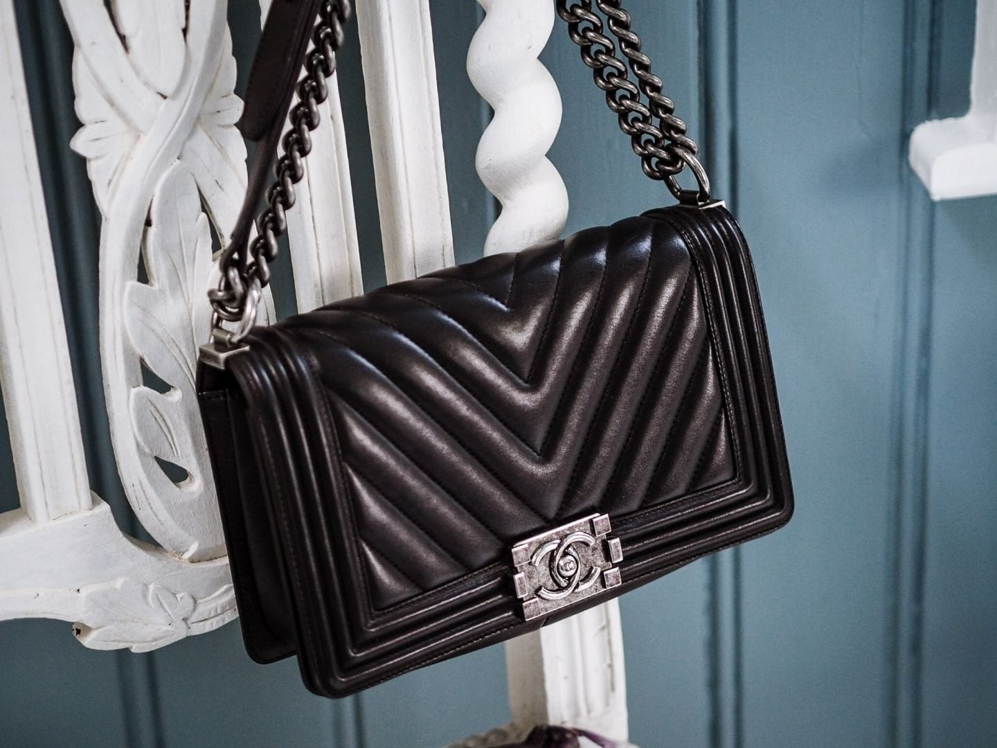 chanel boy bag review what you need to know price authenticity how to authenticate black chevron leather lambskin antique silver metal hardwear hardware