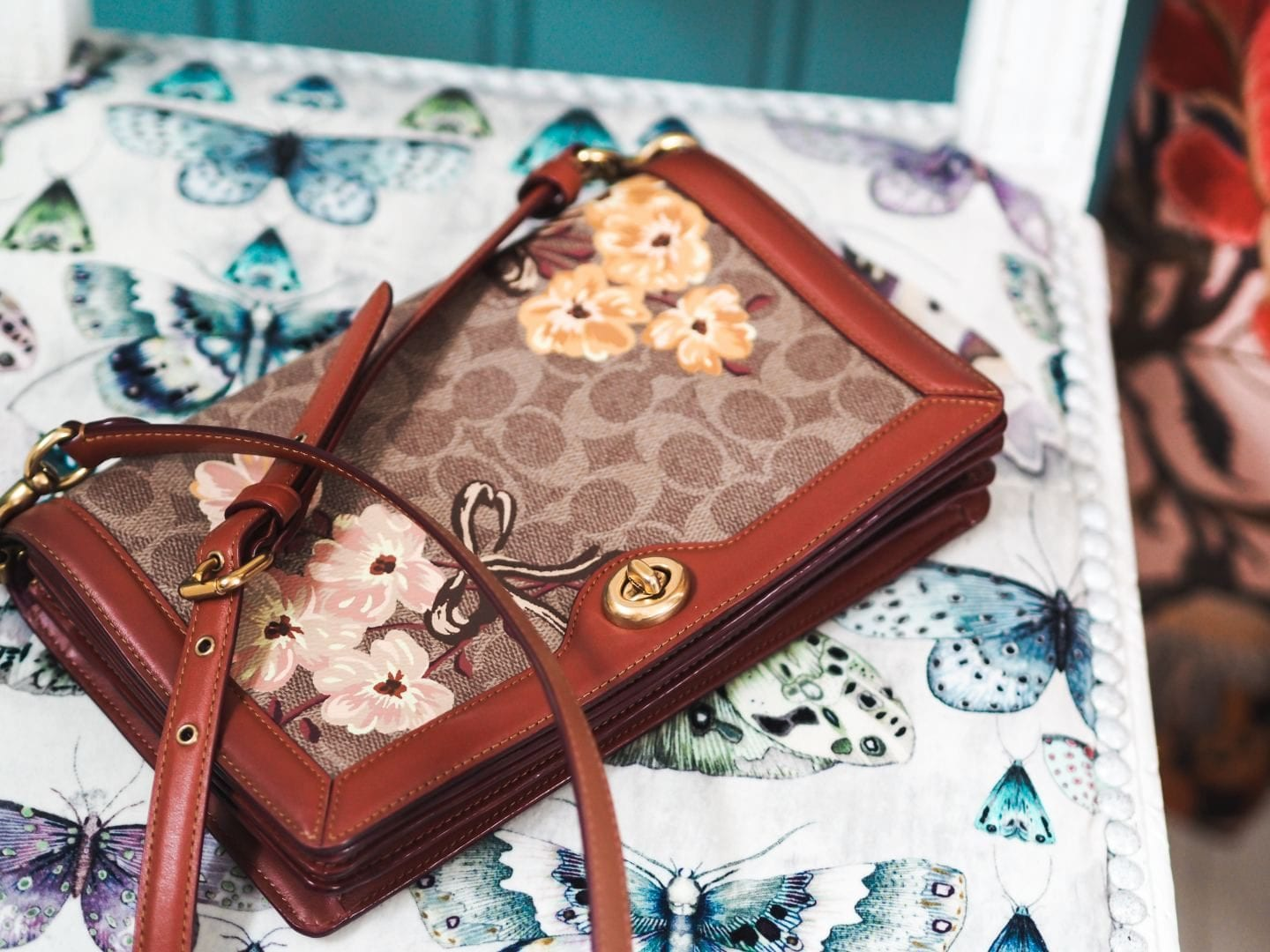brown leather trim monogram canvas Coach Riley Handbag Riley In Signature Canvas With Prairie Floral Print