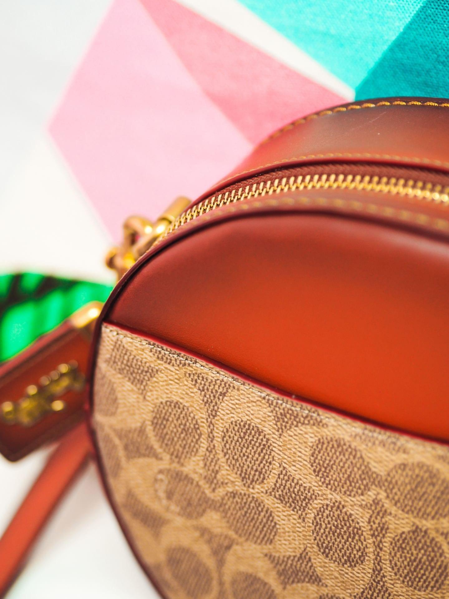 coach canteen crossbody round handbag in signature canvas bag detail monogramemed coated canvas