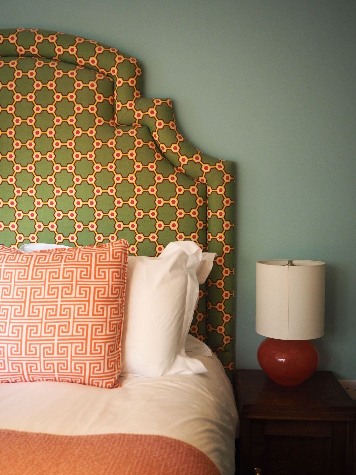 the rose deal kent decor interior design green and orange print headboard