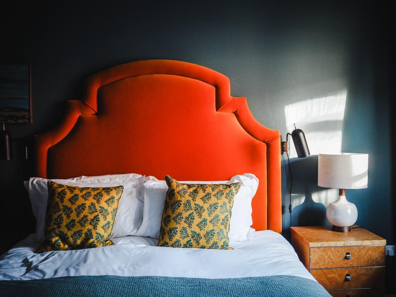 the rose deal kent decor interior design orange headboard
