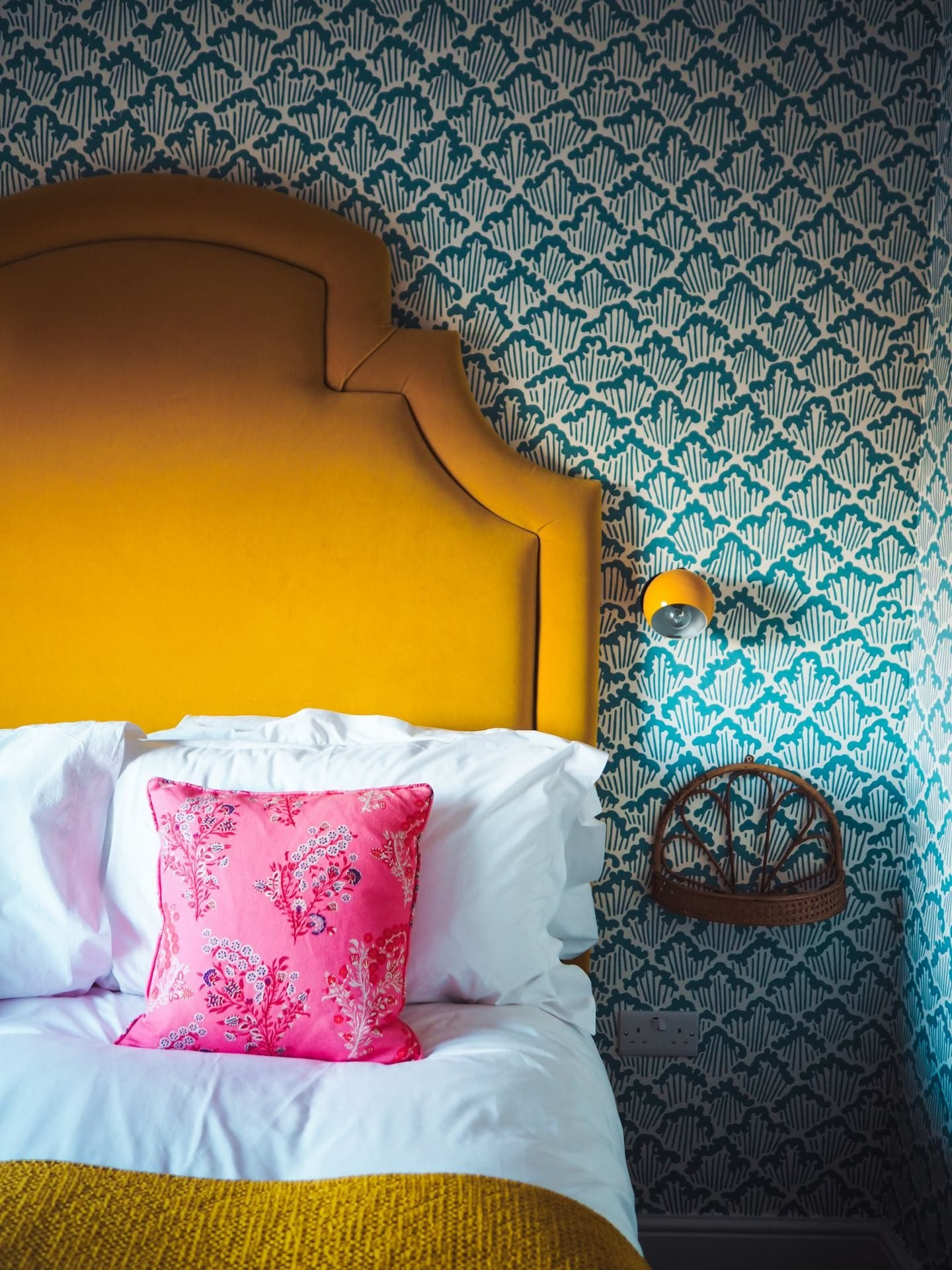 the rose deal kent decor interior design yellow headboard blue print wallpaper