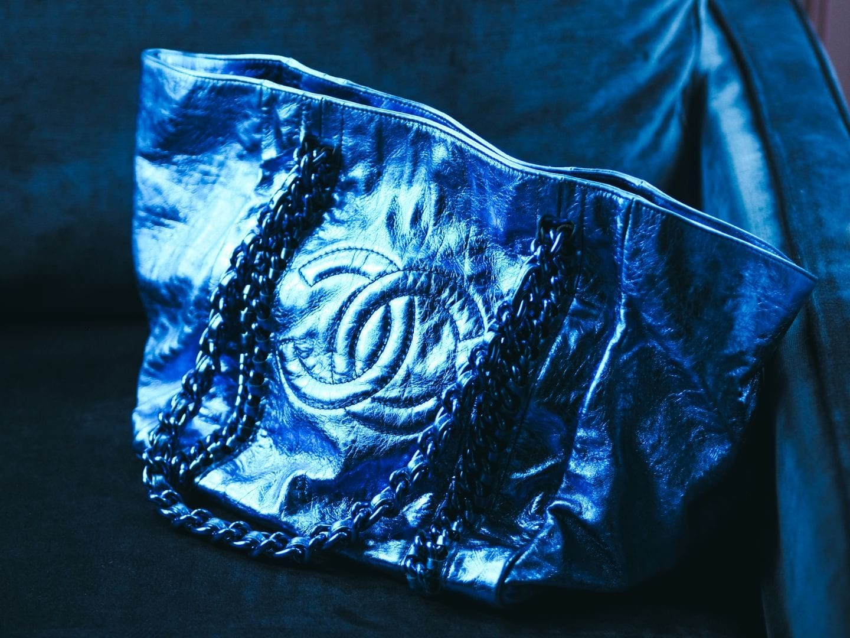 The Chanel Chain Tote Handbag At Auction blue metallic