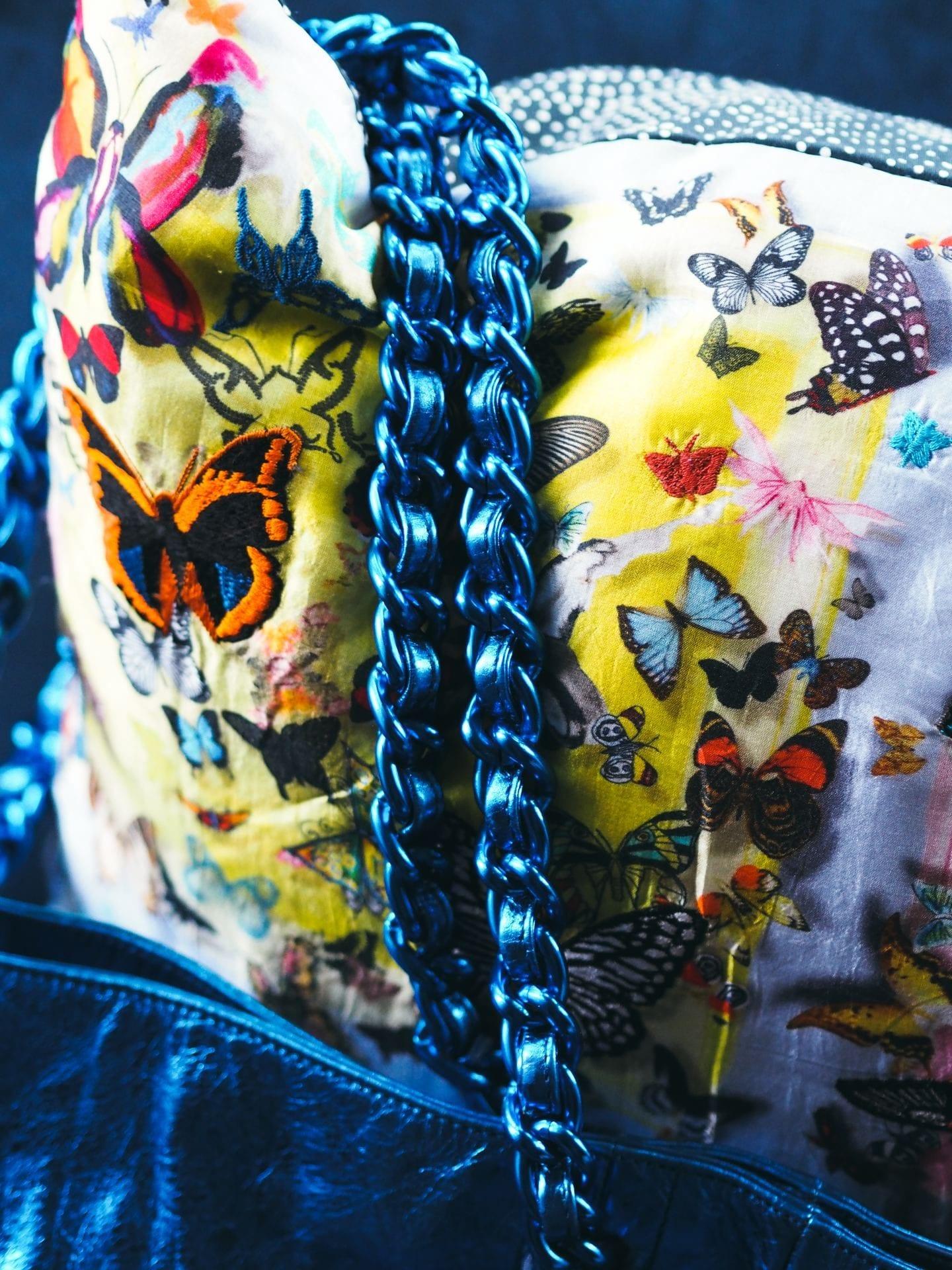 The Chanel Chain Tote Handbag At Auction blue metallic chain strap