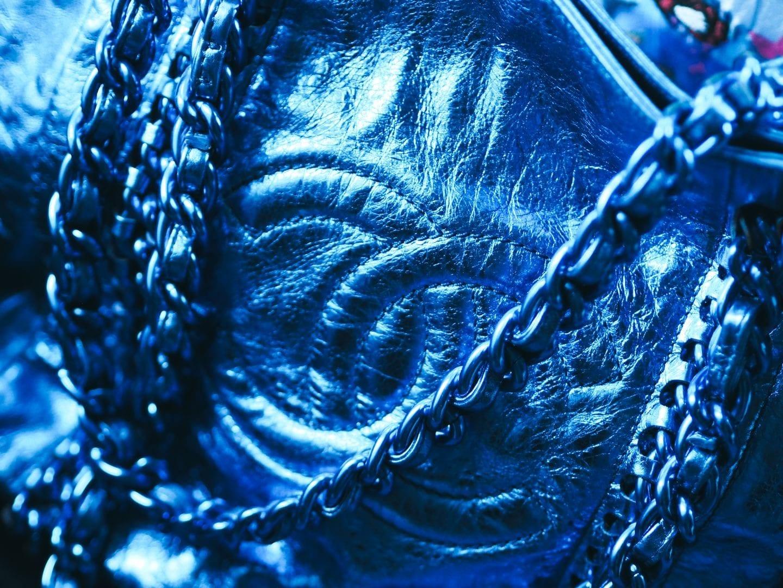 The Chanel Chain Tote Handbag At Auction blue metallic interlocking c's