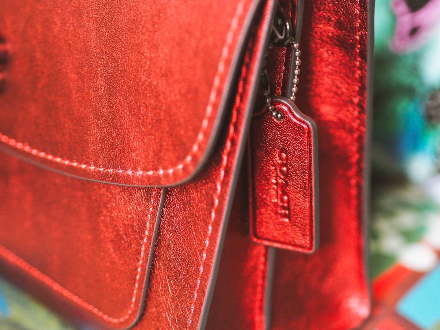 coach parker bag metallic leather red handbag review side view