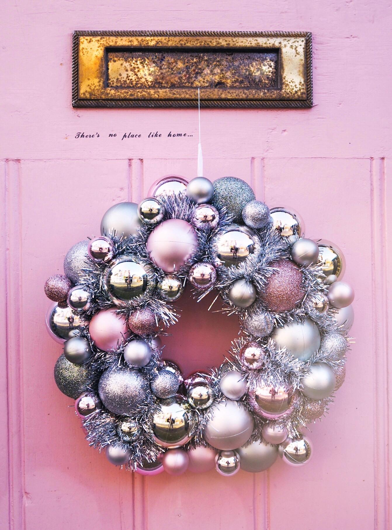 matalan-christmas-2019-wreath pink door there's no place like home door
