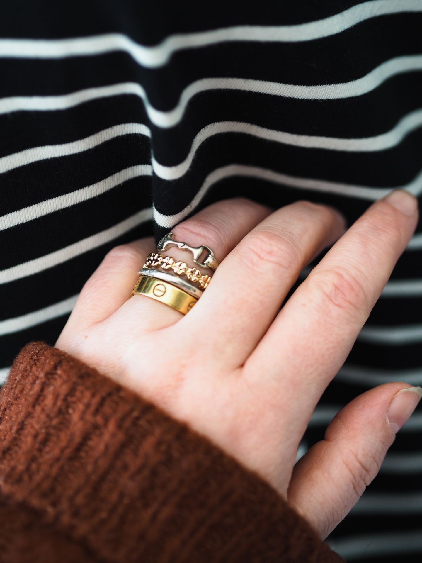 Four Ways To Wear The Cartier Love Ring how to style the cartier love ring stacked up