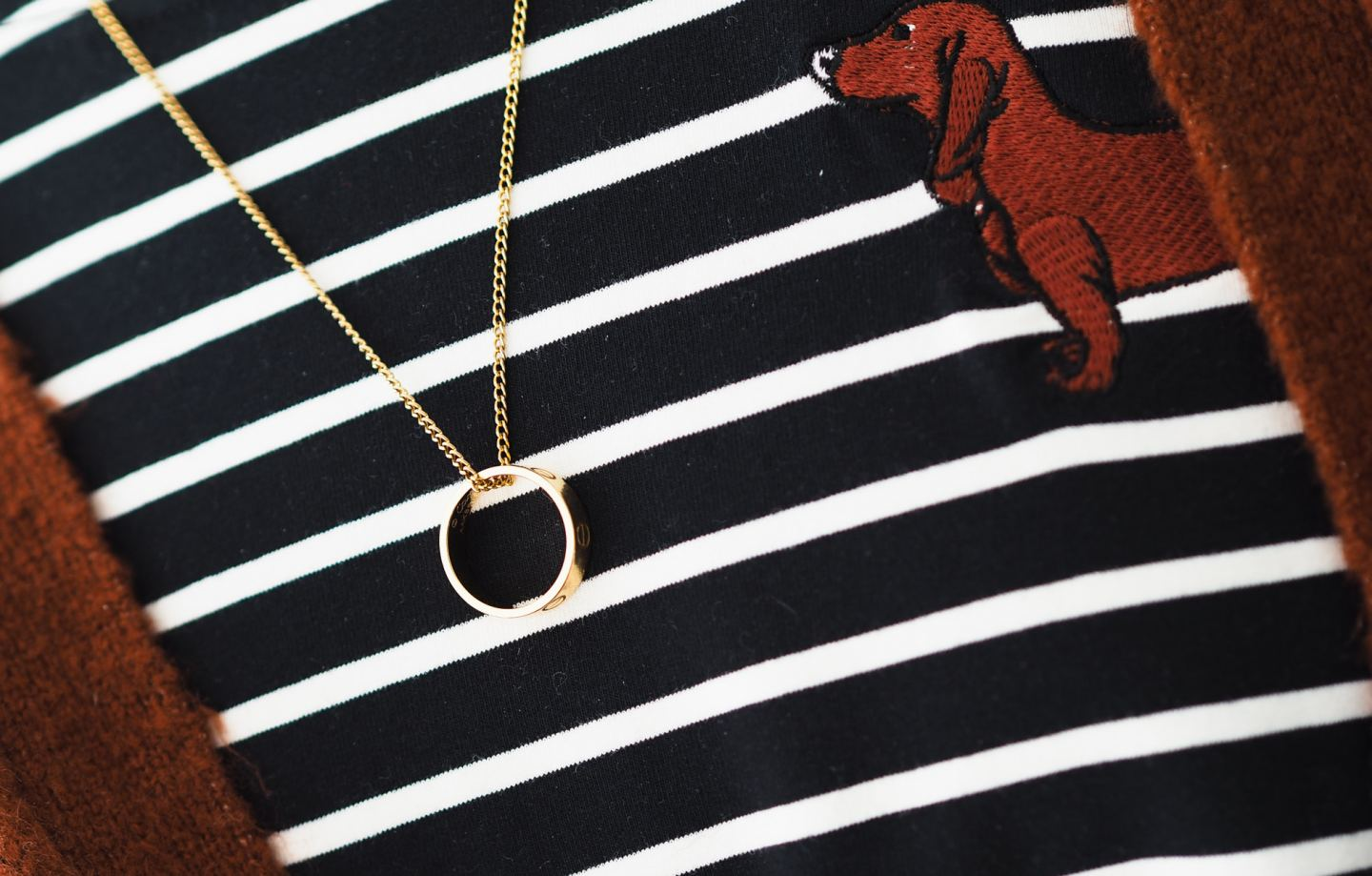 Four Ways To Wear The Cartier Love Ring worn as necklace gold