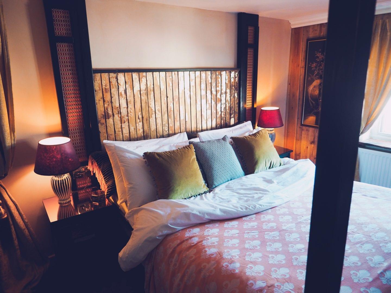 george-and-heart-margate-kent-bedroom-gold-bedframe